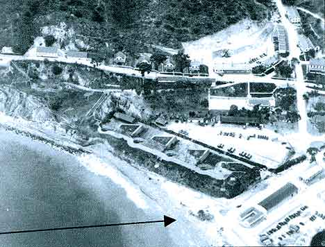 Figure 8.12 Circa 1943 aerial view looking west towards United States Army Fort Rosecrans showing Coast Artillery Battery Wilkeson, which was built in 1898. Fort Guijarros is located beneath the sand in the foreground (see arrow). Fort Guijarros Museum Foundation Photo Collection, P:04-7086.