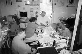 Figure 8.14 Fort Guijarros Museum Foundation laboratory in Building 127, Fort Rosecrans Historic District, Naval Base Point Loma. Featured in the photo are Dale Ballou May at the computer, Ron May near the door, Susan Floyd to his left, Heather Haisten to his right, and G. Scott Anderson at the bottom of the photo.