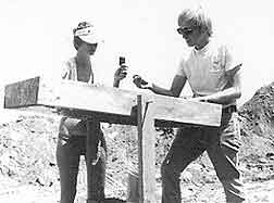 Figure 8.18 Judy Swink (left) and Jim Royle (right) are screening dirt from the first trench and are recovering artifacts for later analysis. Fort Guijarros Museum Foundation Photo Collection.