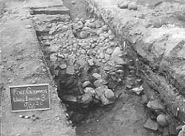 Figure 8.19 This exposure of the architectural ruin shows the fort wall tiles collapsed down the cobblestone ramp that buttressed the outside wall of the fort. Fort Guijarros Museum Foundation Photo Collection, P:81-332.