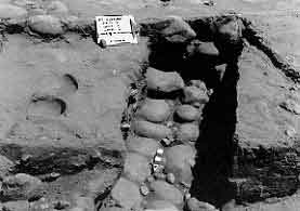 Figure 8.21 The feature is one of twelve layers of cobbles that went into building Strata I, the core wall. It was built inside the fort wall itself and served to strengthen the front part of the merlon. Fort Guijarros Museum Foundation Photo Collection, P:81-7278.