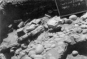Figure 8.24 This photograph shows a collapse episode of Strata VII and VIII rubble, as well as broken tiles with plaster. They tumbled in at different angles on top of yellow sand (Strata VI) and Strata V cobblestone glacis. Fort Guijarros Museum Foundation Photo Collection, P:81-7257.